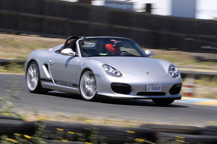 The Boxster Spyder was faster around our test track than the Cayman R despite hauling more weight with less power.