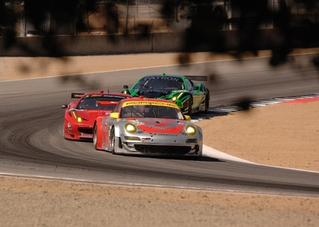 Jörg Bergmeister in the #45 Porsche GT3 RSR leads the Ferrari 458 Italias of Risi Competizione and Extreme Speed Motorsports around Laguna Seca's fast Turn 5. Photo by Randy Leffingwell