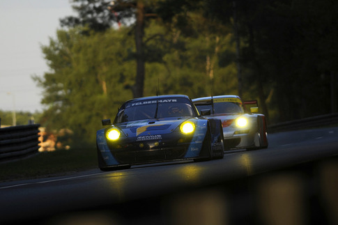 Felbermayr Proton's #77 2012-spec RSR leads a Flying Lizard RSR.