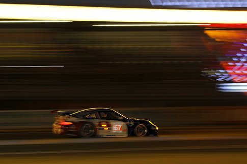 IMSA Performance Matmut's GTE-Am RSR at night.