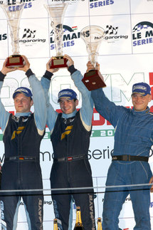 Marc Lieb (left) and Richard Lietz (middle) celebrate on the podium. Photo courtesy Porsche