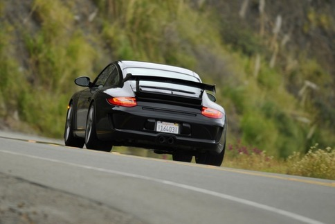 Wide rear tires of the 997-2 GT3 came in handy when deploying its 435-bhp from 3.8 liters. Photo by Bob Chapman/Autosportimage.com