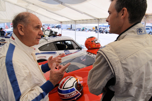 George Follmer (left) and Johannes van Overbeek converse in the pits. Photo by Pete Stout