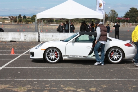 Participants take turns driving a Boxster Spyder. Photo by Damon Lowney