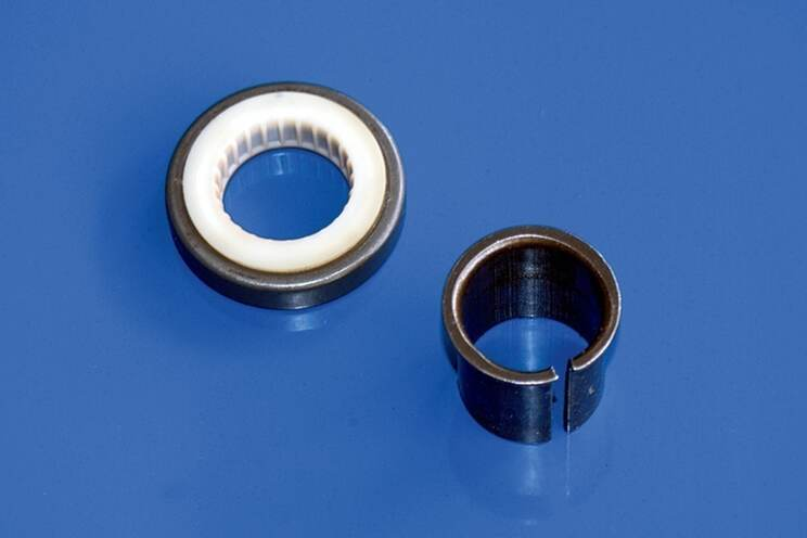 Replacement upper bearing (left), repair sleeve (right).