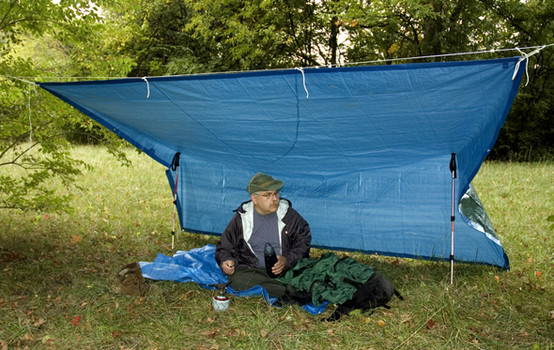 Blue plastic tarp can be used as a hammock shelter