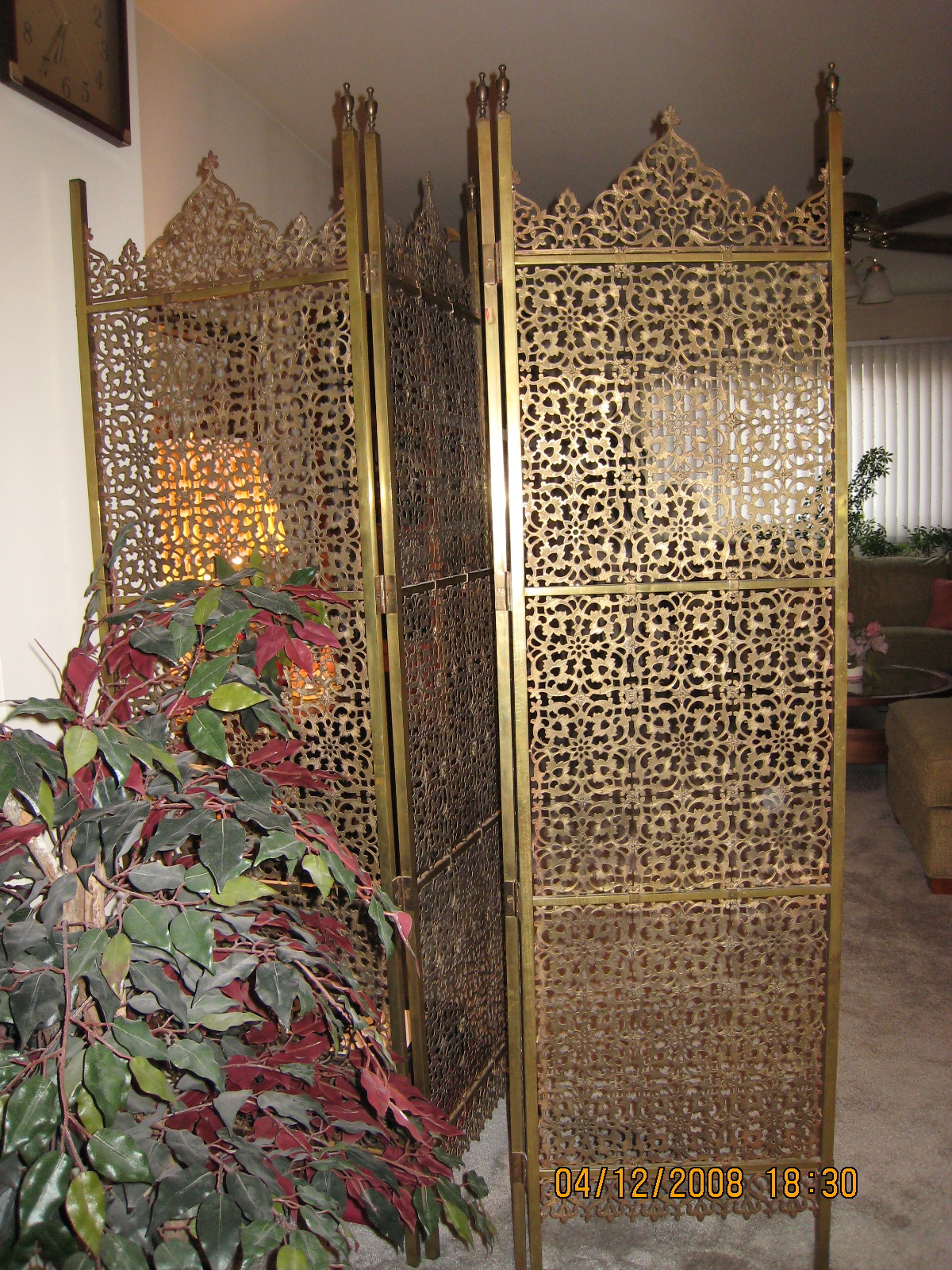 I have a brass intricately carved room divider screen for Room divider art