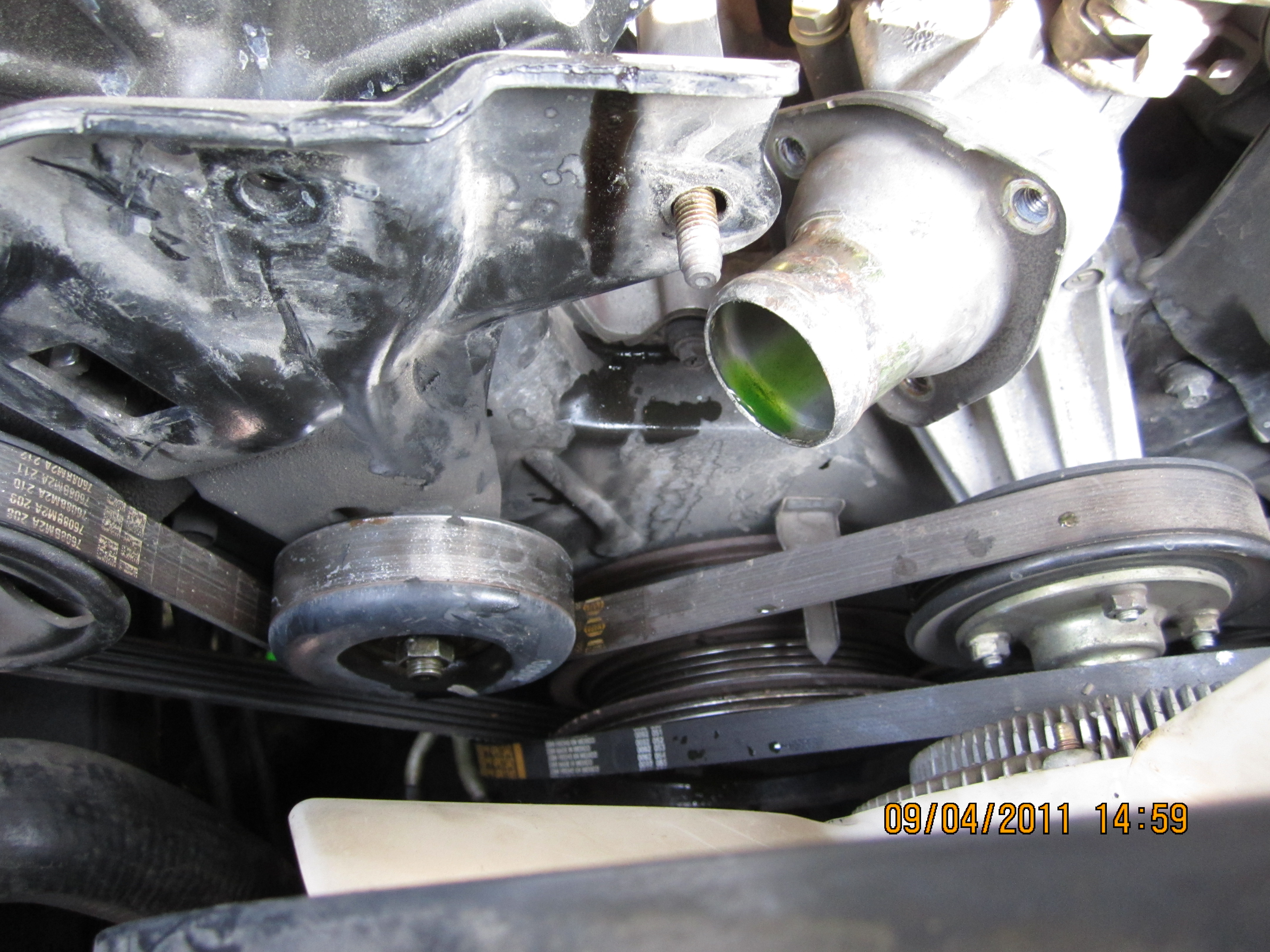 2001 Nissan The Gold Colored Thermostat Housing That You