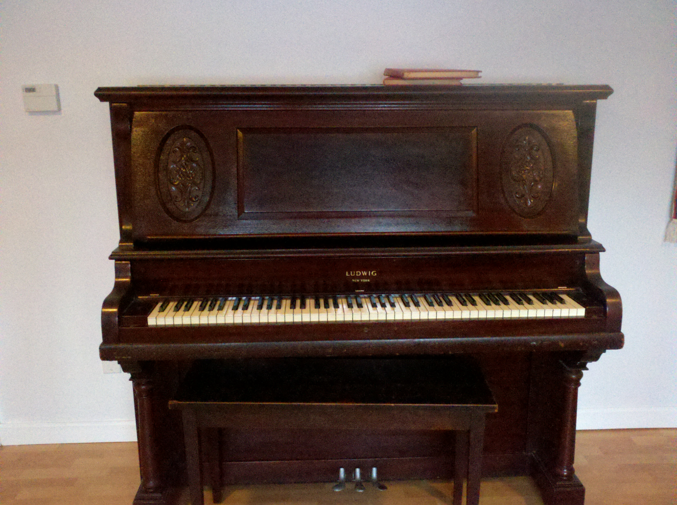 What would a Ludwig & Co upright piano, #94818 be worth?