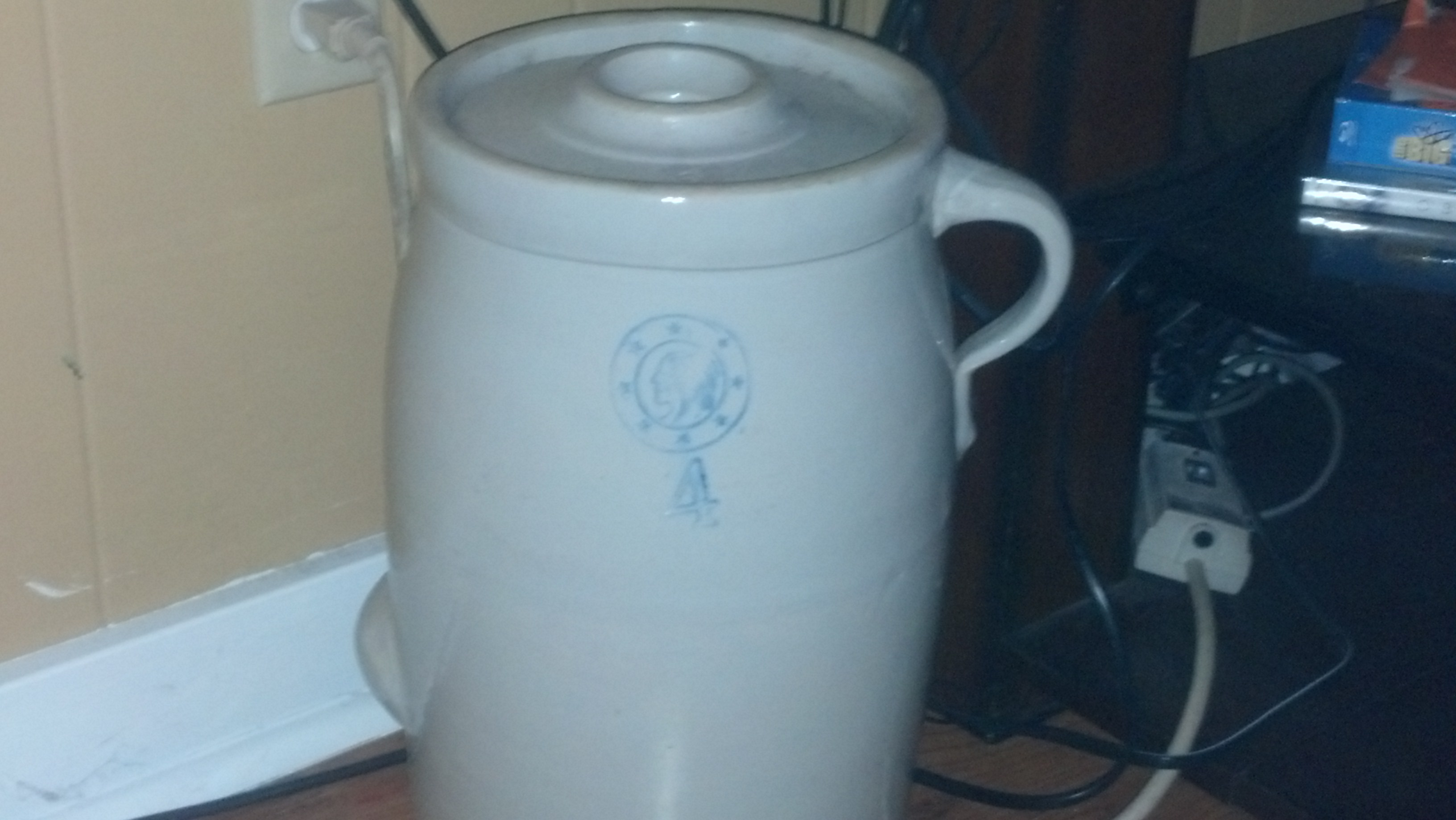 butter churn in great shape with lid. It has an indian head with stars ...