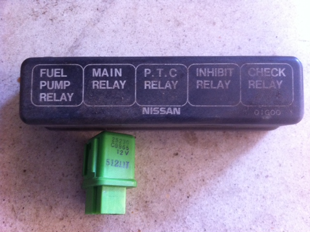 nissan d21 headlight relay location