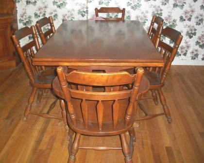 I HAVE A SOLID ROCK MAPLE ANTIQUE DINING ROOM SET THERE IS