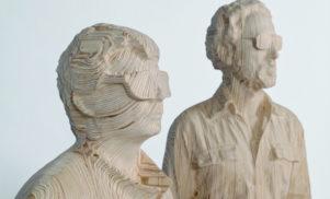 Daft Punk unmasked in intricate wooden sculptures