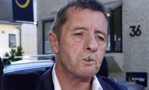 Former AC/DC drummer Phil Rudd remanded after breaching conditions of home detention