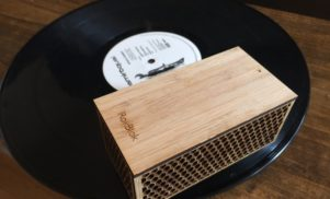 This tiny portable vinyl player works by riding in circles on your records