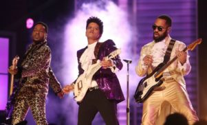 Bruno Mars honors Prince with guitar-shredding Grammys performance of 'Let's Go Crazy' – watch