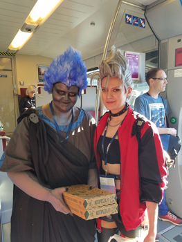 Two cosplayers on the train, on their way to the Hugos.