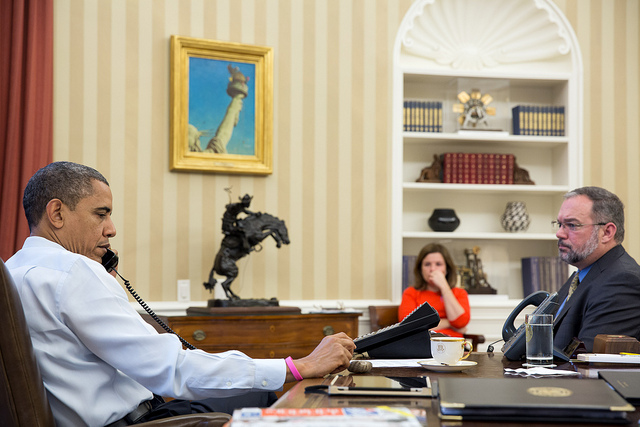 President Barack Obama receives an update on the ongoing response to Hurricane Sandy during a conference call with FEMA Administrator Craig Fugate, Dr. Rick Knabb, Director of the National Hurricane Center, and John Brennan, Assistant to the President for Homeland Security and Counterterrorism, in the Oval Office, Oct. 26, 2012. Alyssa Mastromonaco, Deputy Chief of Staff for Operations, and Richard Reed, Deputy Assistant to the President for Homeland Security, are seated at right. (Official White House Photo by Pete Souza)