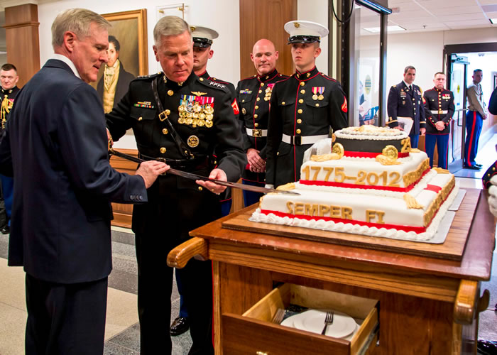 "Navy Secretary Ray Mabus and Marine Corps Commandant Gen. James F. Amos cut a cake at the Marine Corps birthday celebration at the Pentagon on November 7. The Marine Corps celebrates its 237th birthday on November 10. An excerpt of the annual birthday message written in 1921 by Gen. John A. Lejeune, the service's 13th commandant, reads, ""Generation after generation of Marines have grown grey in war in both hemispheres and in every corner of the seven seas so that our country and its citizens might enjoy peace and security."" (Photo: Chief Petty Officer Sam Shaver/U.S. Navy)"