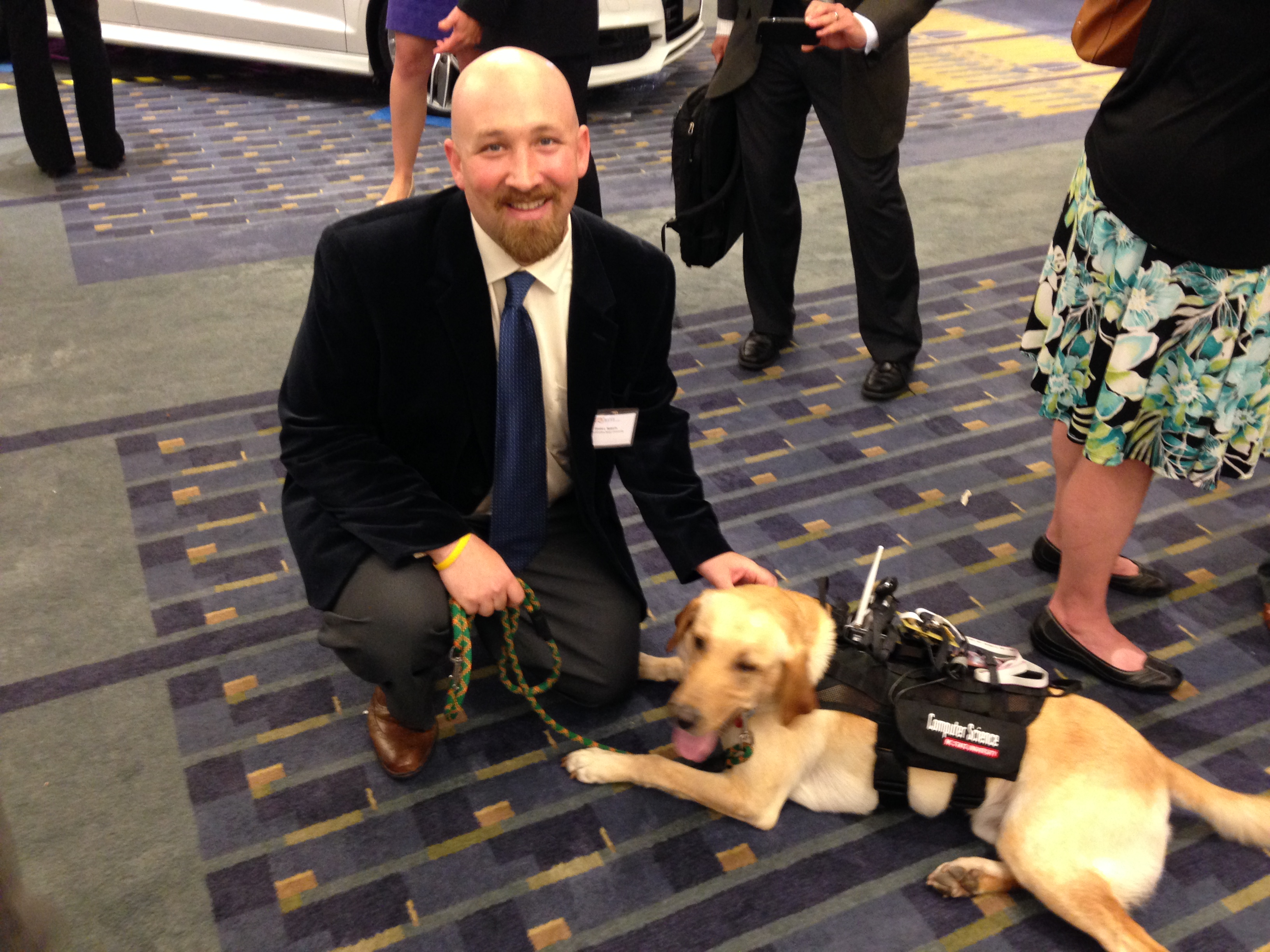 David Robers with Diesel, a search and rescue dog that is part of the SERS program that uses rescue dogs to collect data from disaster zones.