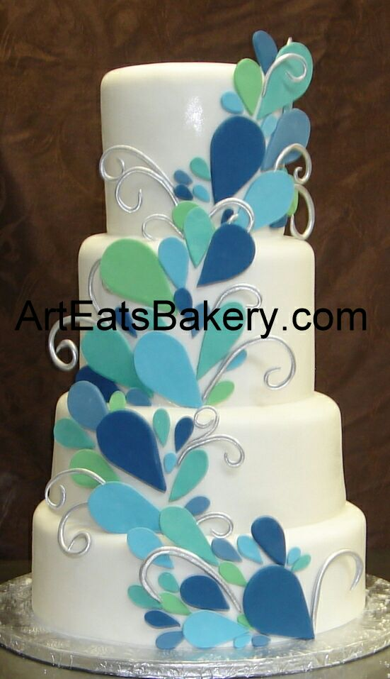 custom designed green blue and teal sugar sculpture peacock four tier fondant wedding cak.jpg