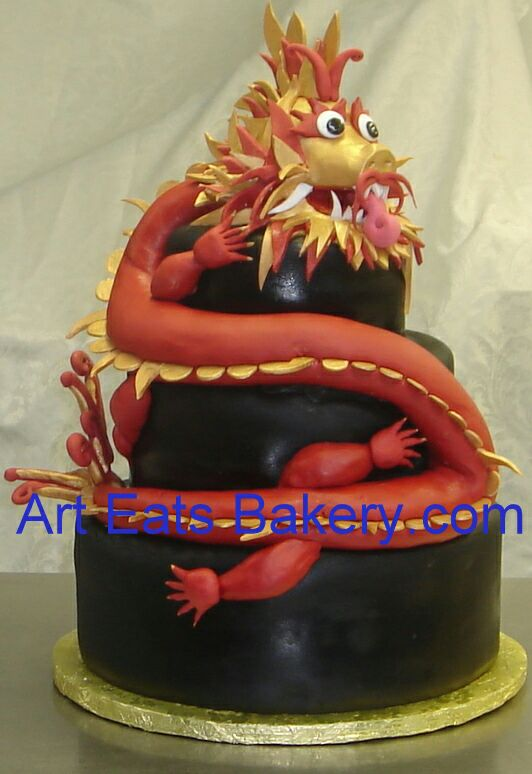 black fondant three tier cake with edible 3d red and gold dragon.jpg