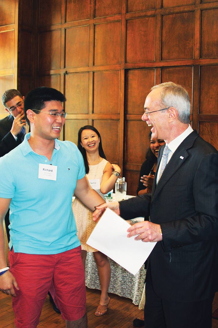President Reif congratulates members of the Class of 2013