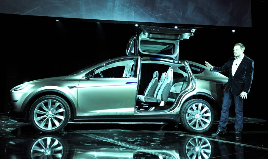 tesla s new car a luxury suv with wings   mit technology
