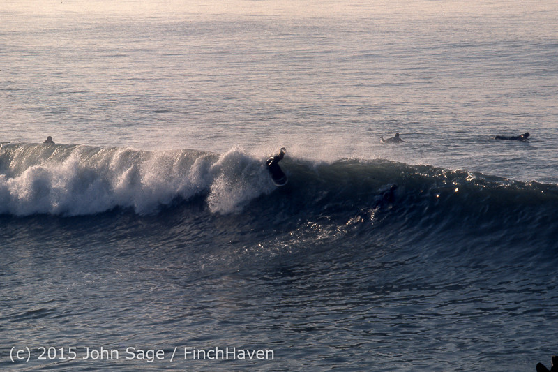 Surfing_at_Huntington_Beach_Pier_CA_early_1970s-02