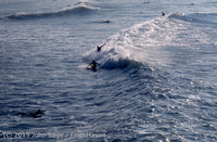 Surfing at Huntington Beach Pier CA early 1970s 03