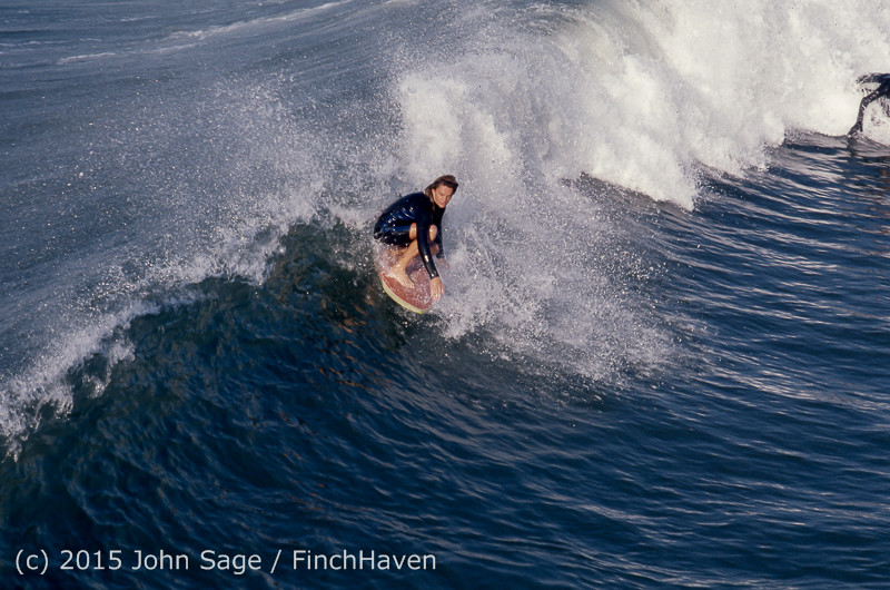Surfing_at_Huntington_Beach_Pier_CA_early_1970s-20