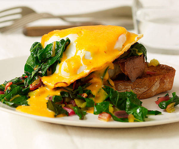 Fried Eggs with Garlicky Chard and Saffron-Red Pepper Hollandaise
