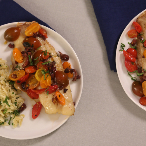 Grill roasted fish in parchment with tomatoes and olives for Fish in parchment recipes