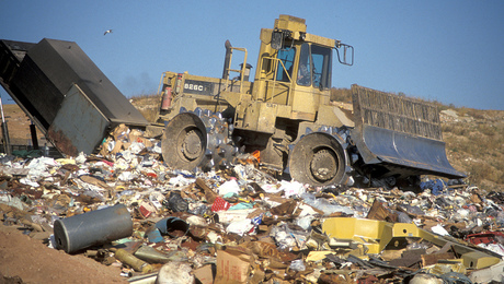 At a landfill in Wisconsin,a bulldozer spreads out mounds of garbage. The EPA has proposed new rules that would require more landfills to capture methane and carbon dioxide.