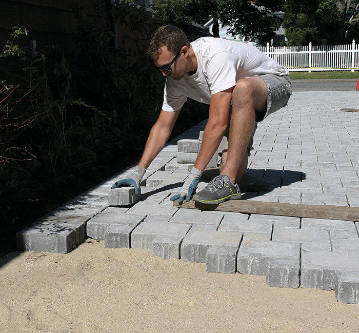 Laying concrete pavers fine homebuilding for Base for concrete driveway