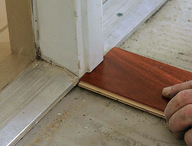 TRIM DOOR CASINGS BEFORE YOU START: To Make The Installation Easier, Itu0027s A  Good Idea To Cut Door Casing So That The Flooring Can Slip Beneath.