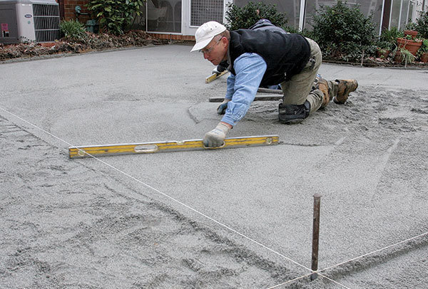 A concrete paver patio from the bottom up fine homebuilding for Base for concrete driveway