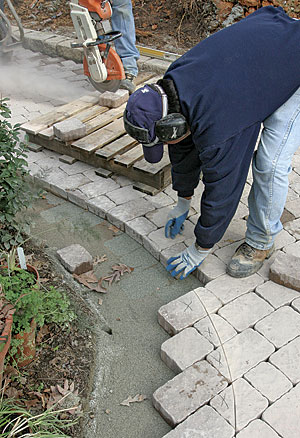 Anchor Pavers Around The Edges. On This Job , We Used A Masonry Border  (from Belgard) With Plastic Inserts That Poke Into The Pavers And Then Are  Spiked ...