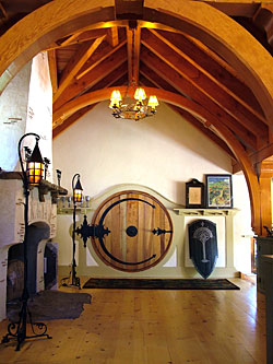 The round door is hung on a single hinge designed by blacksmith Michael Coldren of North East Md. Designing hardware strong enough to handle the torque of ... & Inside the Hobbit House - Fine Homebuilding pezcame.com