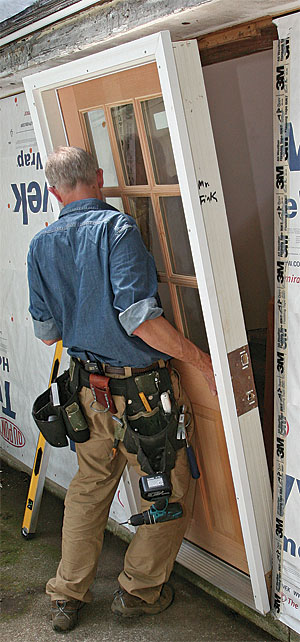 Install a prehung exterior door fine homebuilding for Front entry door installation