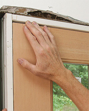 Check the space between the top of the door and the head jamb on the latch side so that you know where to shim first. & Install a Prehung Exterior Door - Fine Homebuilding