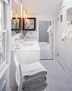 Wonderful This Small Bathroom Is Simple In Style And Decoration But The Artful Light  Fixtures And Medicine Chest Bring The Eye To The Ceiling, Visually  Enlarging The ...