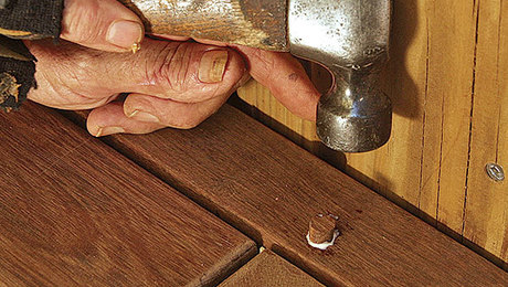 After driving the screw into the deck frame, glue the plug in place with Titebond III or epoxy, and tap it snug with a hammer. Finally, using a sharp chisel, knock off the top of the plug so that it is flush with the decking.Chris Ermides