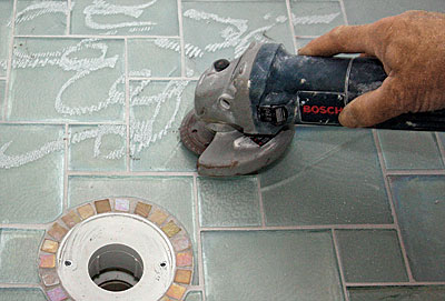 How do you build a shower pan for tile?