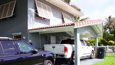 This carport was to be remodeled into a garage. We needed to match all the house details and figure out a soffit venting strategy.