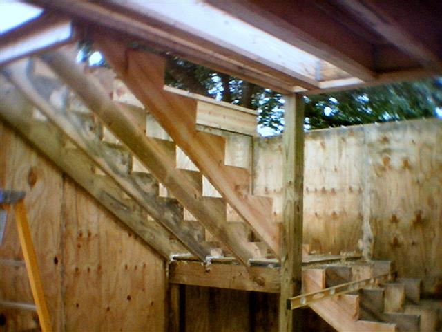 Stairway Has Four Supports On Each Flight And Cut To A Shallow Rise Run Stair Risers Treads Are Framer Made Alternating P T Lumber Yellow Pine