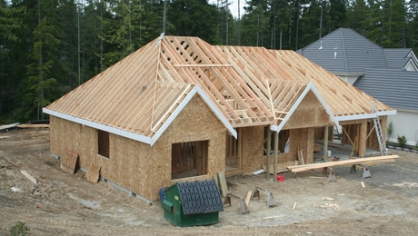 Roof slopes were 8-12 and 10-12. My framing partner Matt and I framed this roof just the two of us. Some of the rafters were 28' and 30' green doug fir.
