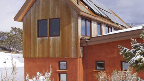A new take on an old method.  Strawbale construction is experiencing a revival. Coupled with new technology -- solar collectors, it's an interesting mix of old and new. To read more about this house, go to http://www.greenbuildingadvisor.com/homes/energy-efficient-strawbale-home-colorado-rockies