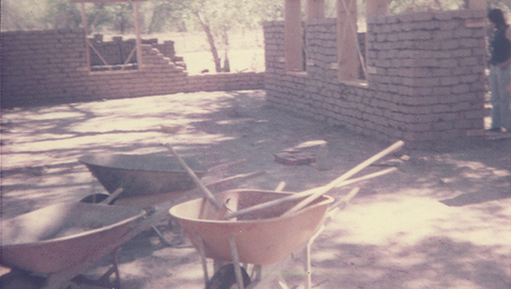Adobe houses are built today the same way they have been for thousands of years. Except that today we have wheel barrows and machines that make brick-making faster. Click to enlarge