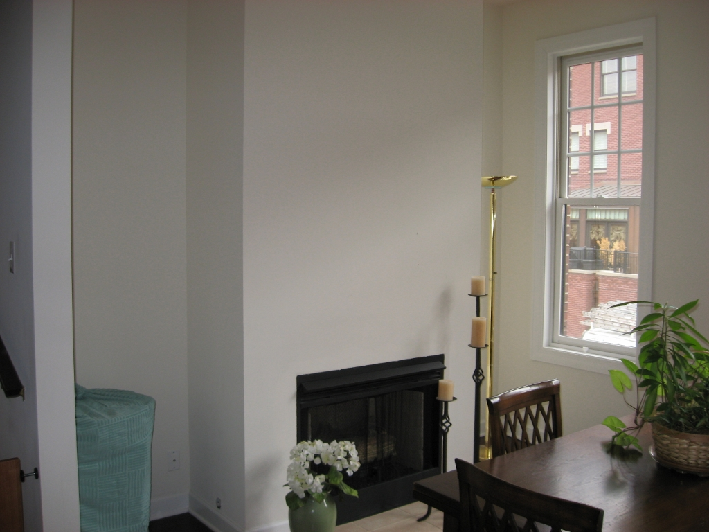 townhome fireplace built ins wainscoting and molding before